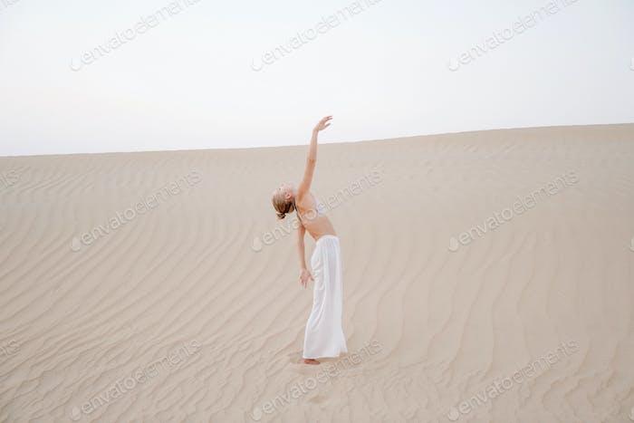 Woman in the desert full length