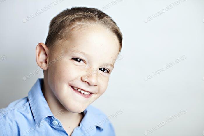 cute elementary aged boy in a blue sunday shirt