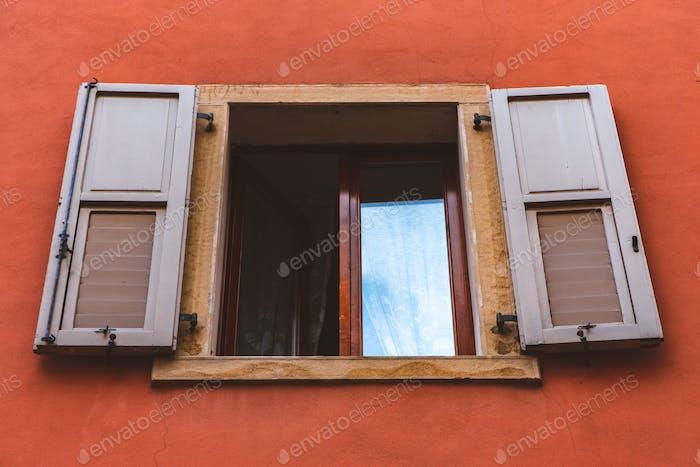 Italian city village open window with orange red walls