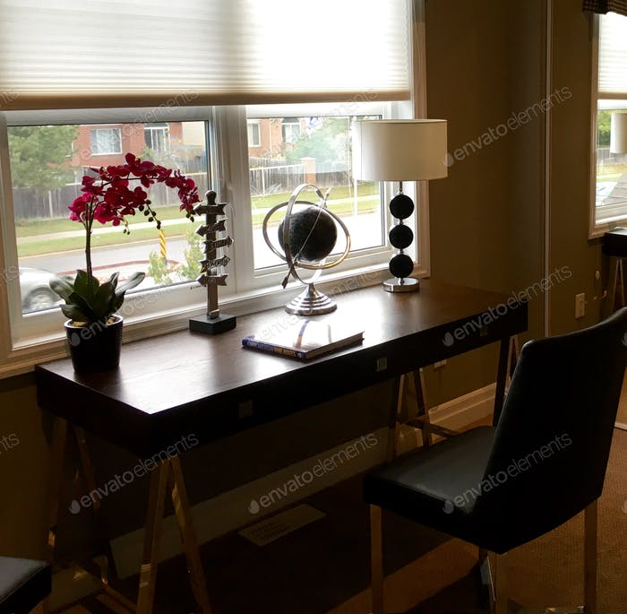 Desk in front of a window.
