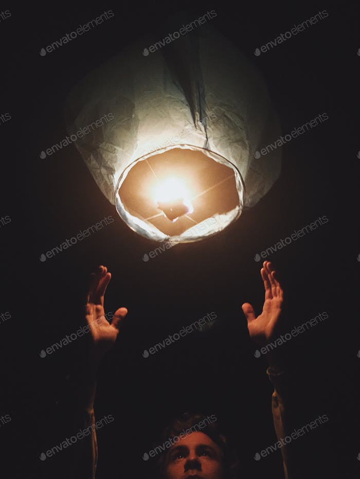 Releasing a sky lantern