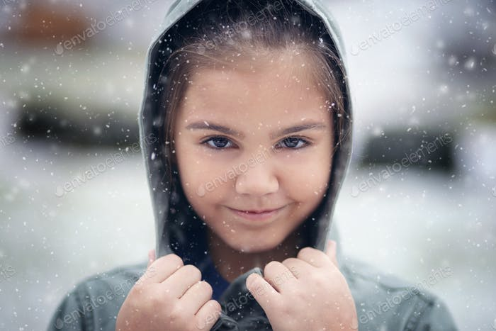 Young girl in the snow face shot