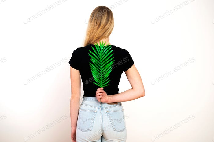 Green fern on female back,spine and woman health concept