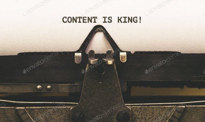 Content is King, Text on paper in Vintage type writer machine from 1920s closeup with paper