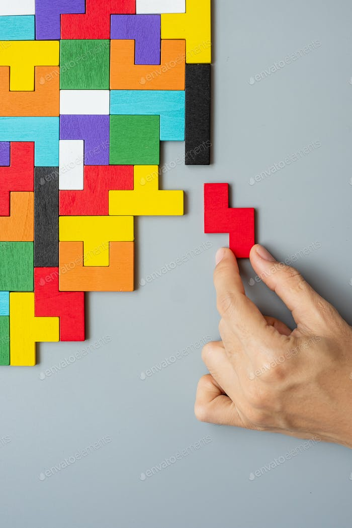 geometric shape block with colorful wood puzzle piece background. logical thinking, business logic