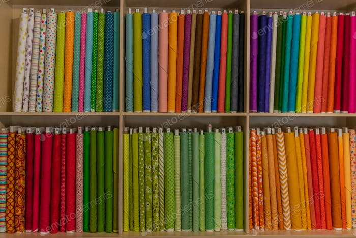 Colorful bolts of fabric on the shelf