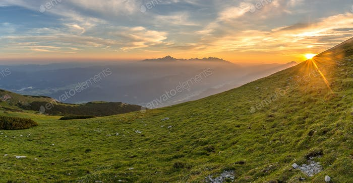 Beautiful sunset in the mountains with the highest mountain in Slovenia, Triglav, in the background.