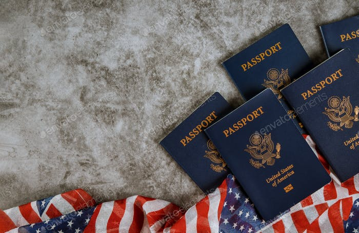 American passports and flag with the symbols of the United States of America.