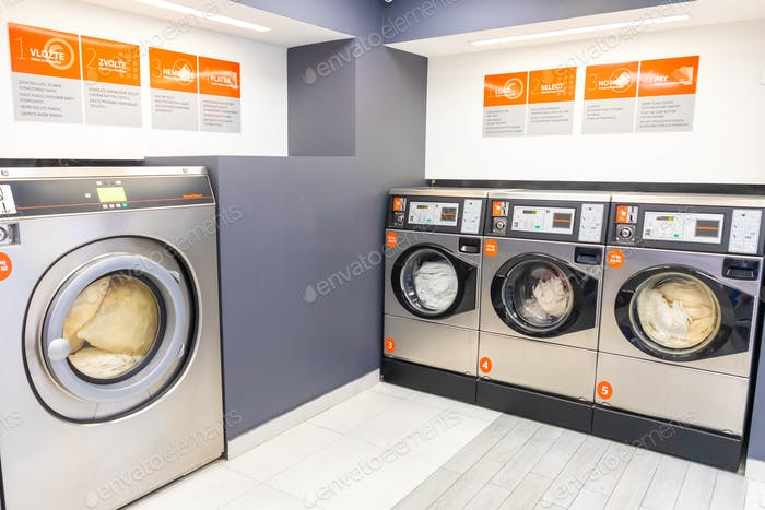 A downtown rise laundry room with Speed Queen front load washers and dryers in Prague, Czech Republi