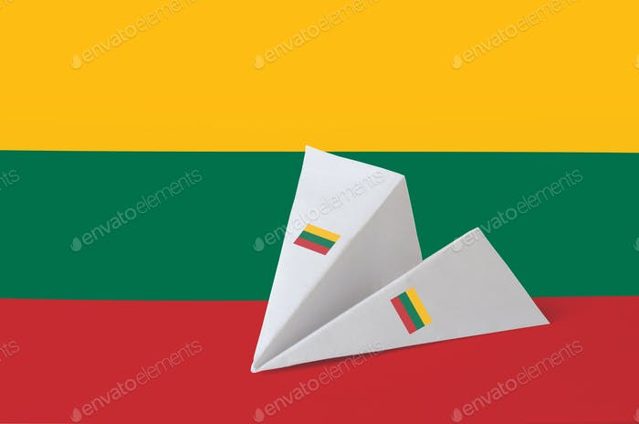 Lithuania flag depicted on paper origami airplane. Oriental handmade arts concept