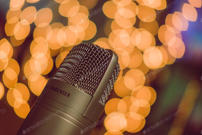 Condenser microphone against blurred lights
