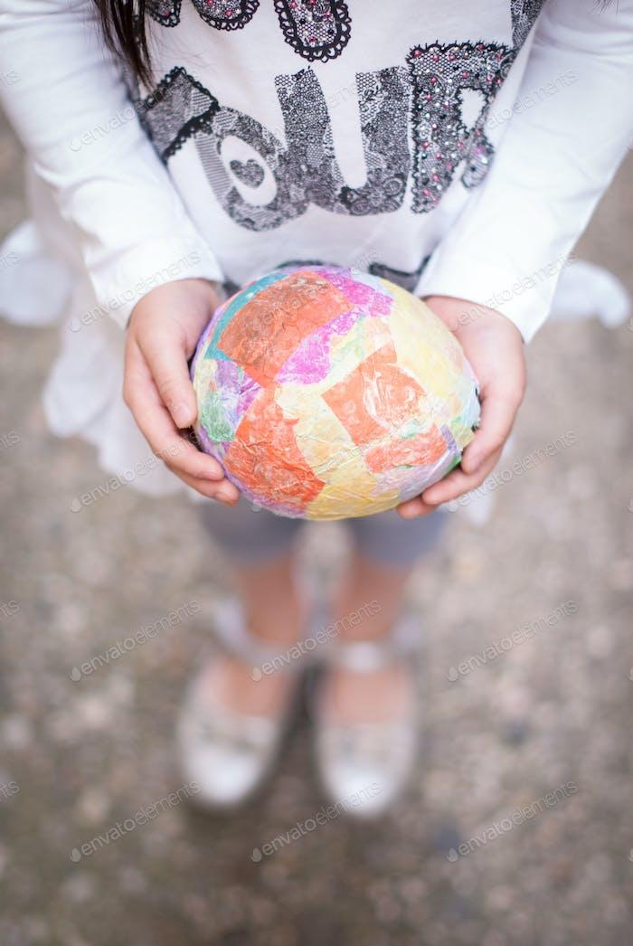 Girl holding paper crochet egg