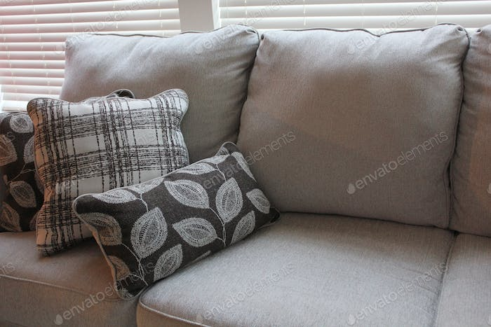 Soft furnishings, home decor, throw cushions on the couch