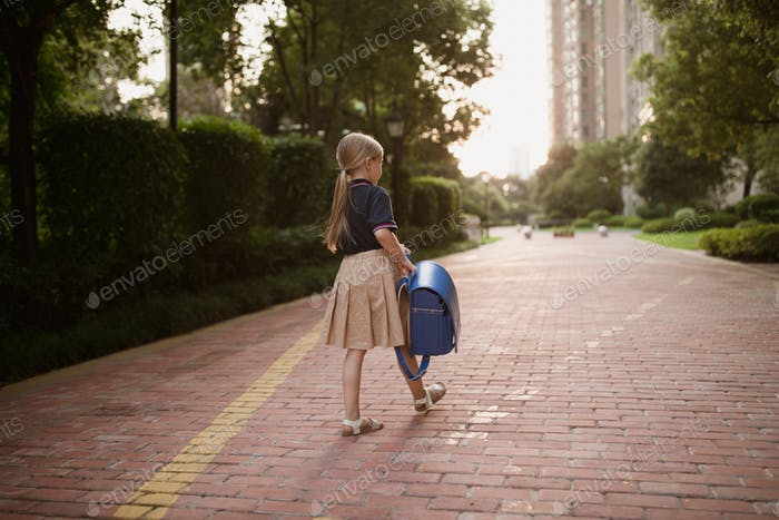 Back to school. Little girl from elementary school outdoor. Kid going learn new things 1 september
