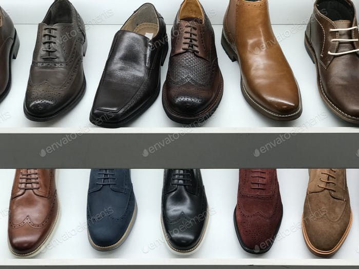 Two rows of men's shoes are brightly lit