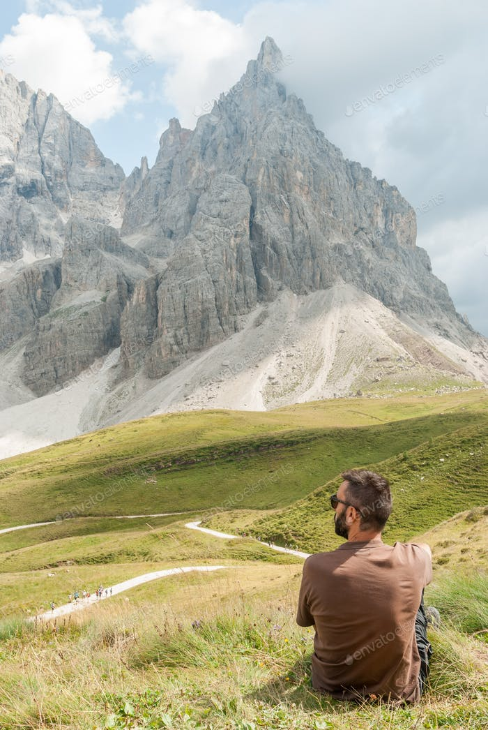 Pale di San Martino, Italy - August 20, 2018: man in the back admires the landscape