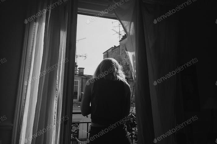 girl on balcony in Paris