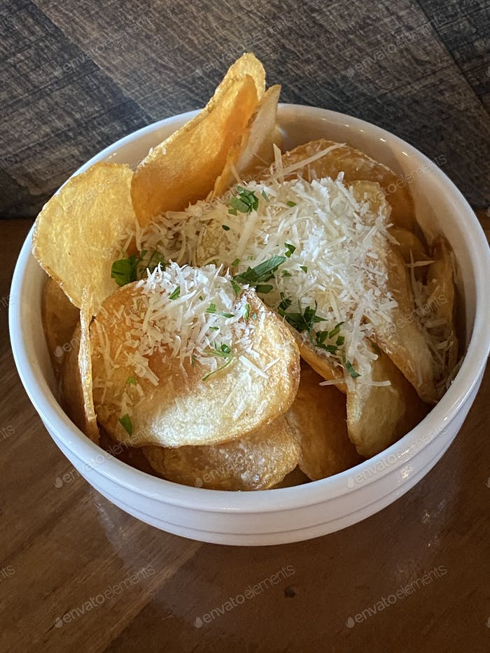 Potato chips with shredded cheese