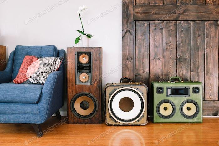 Vintage stereos speakers displayed in a living room