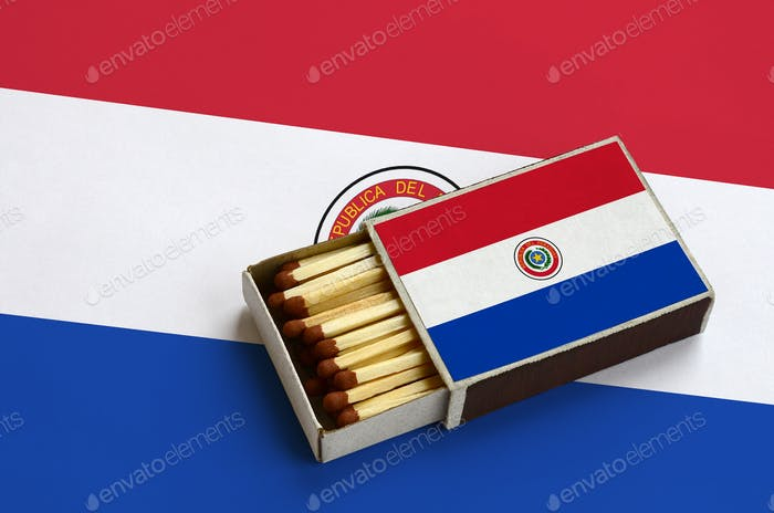 Paraguay flag  is shown in an open matchbox, which is filled with matches and lies on a large flag.