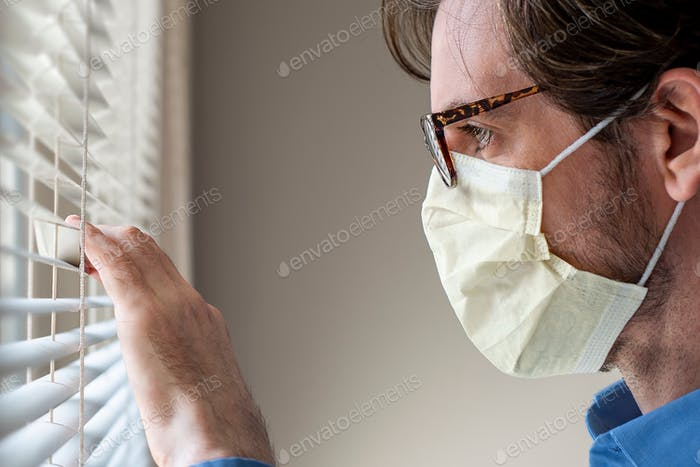 Face mask looking out window blinds