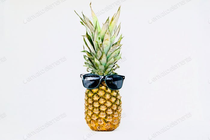 Pineapple dude wearing sunglasses with plenty of white space for text and copy