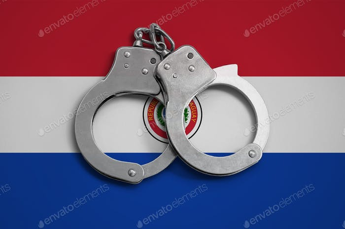 Paraguay flag  and police handcuffs