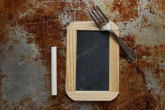 Chalkboard on baking sheet with chalkboard and fork