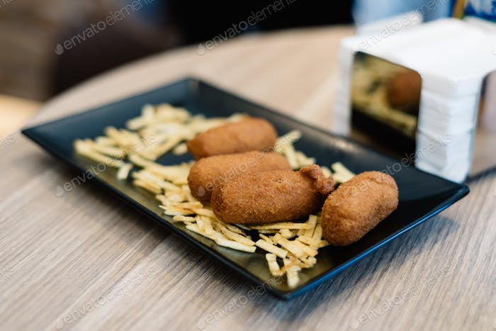 Close up of croquettes with potatoes. Focus on foreground