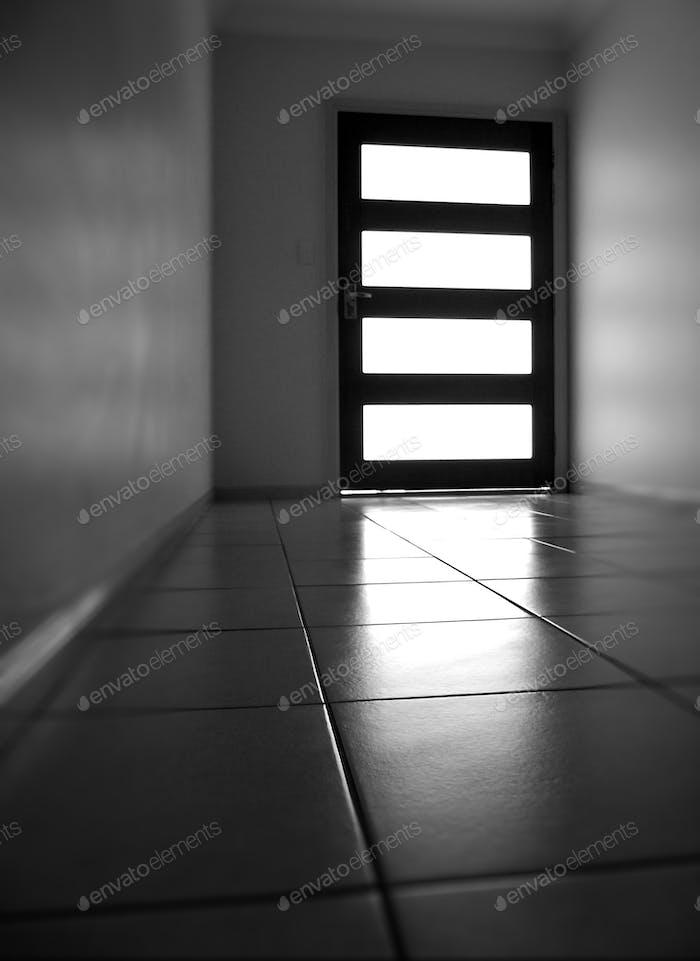 Tiled floor leading towards the front door