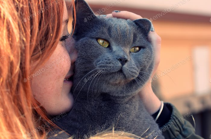 Freckles girl with cat