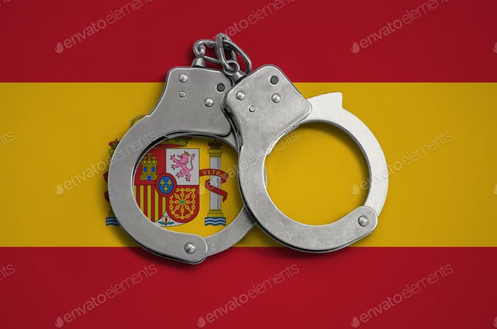 Spain flag  and police handcuffs
