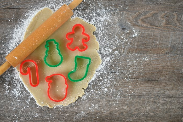 Baking Christmas cutout cookies with Christmas stocking candy cane cookie cutters gingerbread man