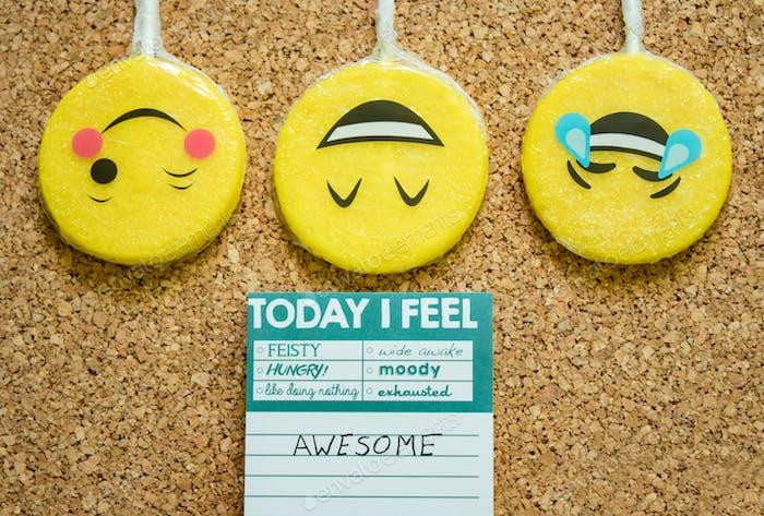 Emojis on a corkboard background