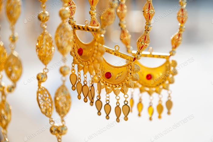 Golden jewelry at traditional Emirati market, closeup