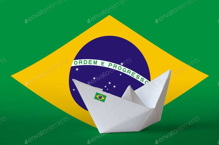 Brazil flag depicted on paper origami ship closeup. Oriental handmade arts concept