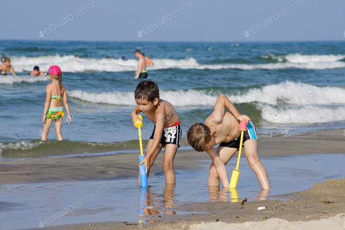 Children play by the water.