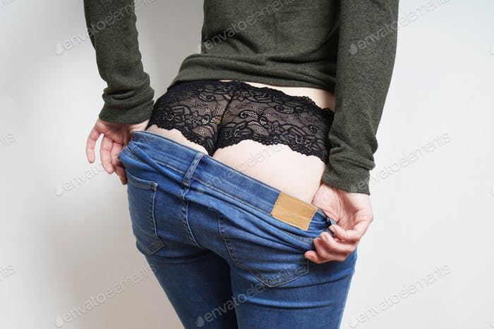 midsection of unrecognizable woman undressing
