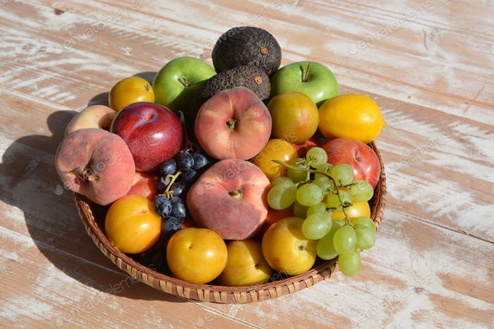 Organic fresh ripe fruits, including nectarines, peaches, grapes, plums apples and avocados