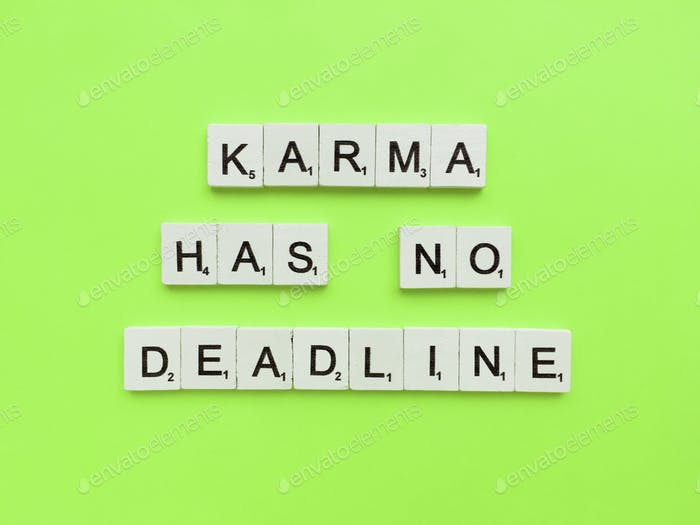 Karma has no deadline scrabble letters word on a green background