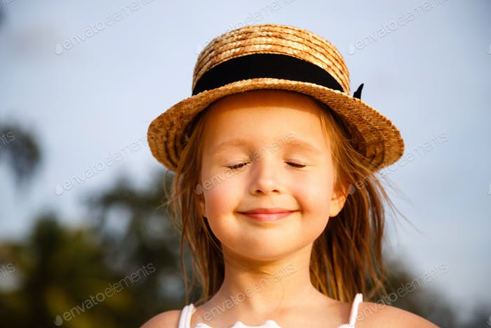 ⭐️⭐️⭐️ Nominated ⭐️⭐️⭐️ Portrait of happy little girl in the summer hat which standing outdoor with