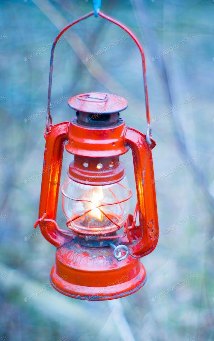 a kerosene lamp lit illuminates