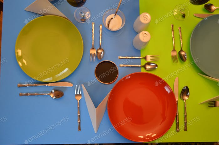 table set for three.  Bright Colors.