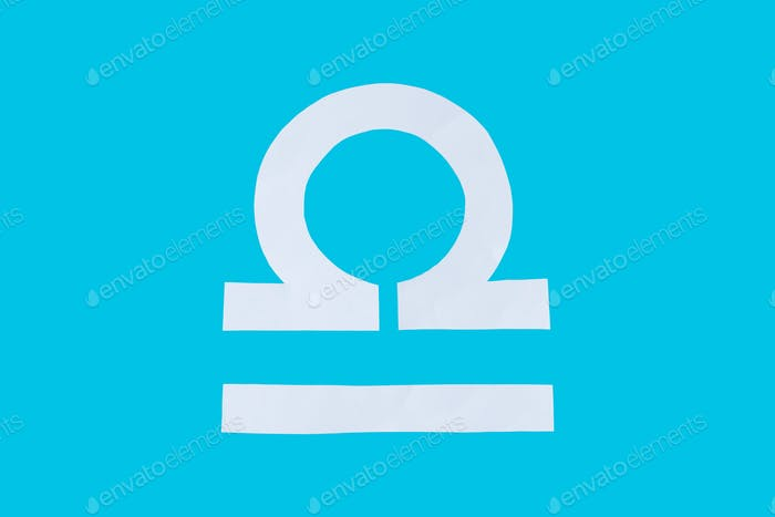 paper cut horoscope sign Libra isolated on a blue background