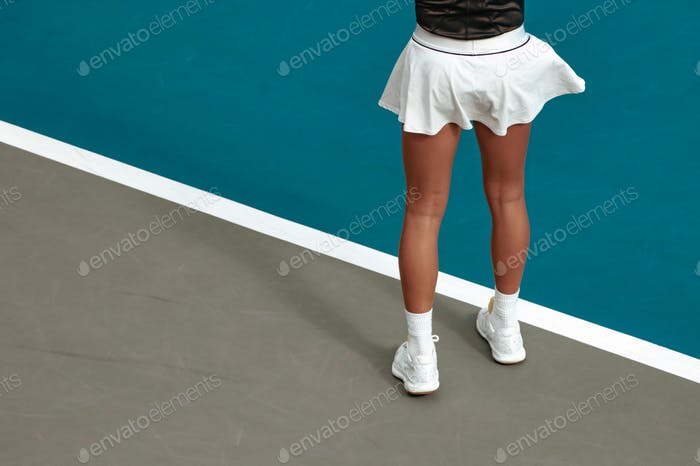 low section minimal of girl standing on tennis court
