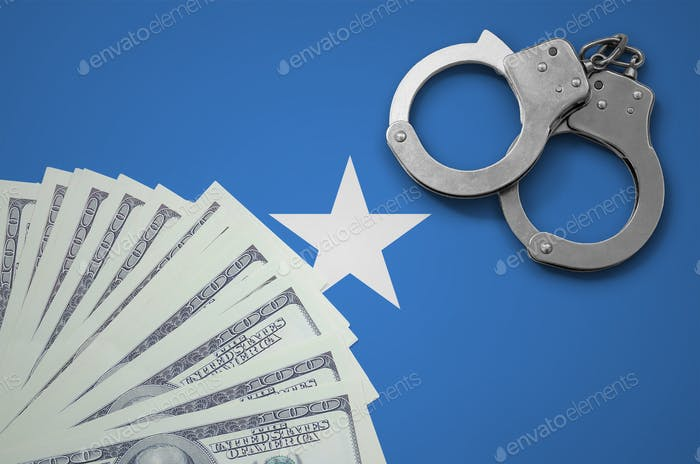 Somalia flag  with handcuffs and a bundle of dollars
