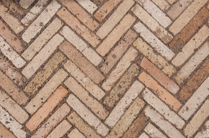 La textura de los adoquines. Patrón de espiga en la carretera del parque. Adoquín en zigzag.