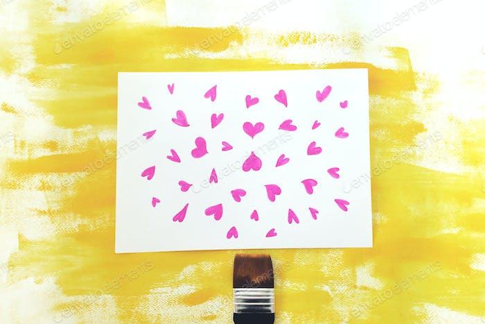 Pink heats on yellow background