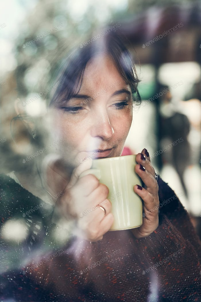 Portrait of woman drinking a coffee. Real people, authentic situations