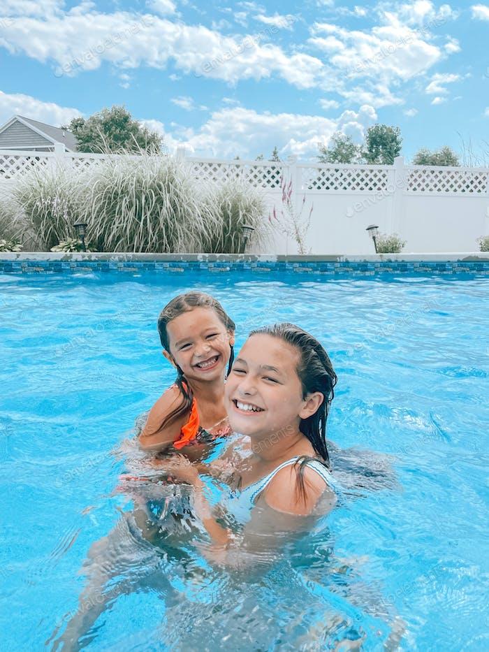 Sisters swimming